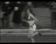Roger Bannister breaks four minute mile